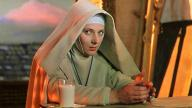 A nun sitting surrounded by startling, hyperreal orange evening light in Michael Powell and Emeric Pressburger's Black Narcissus (1947)
